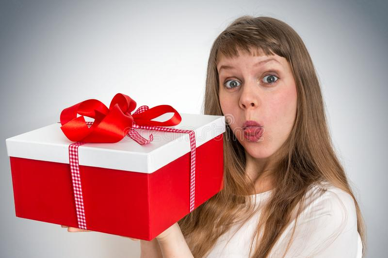 Pretty smiling woman with red gift box stock photos