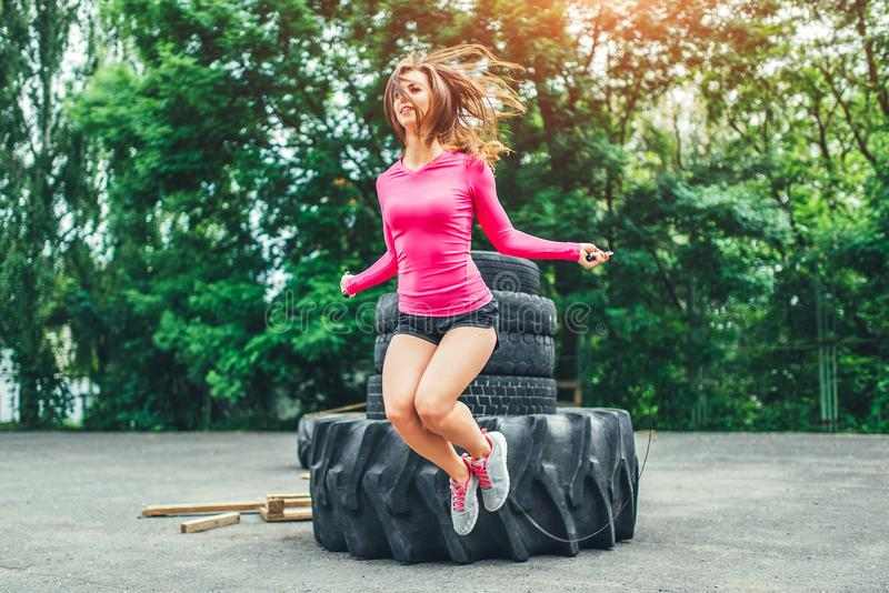 Cute sporty girl with rope training outdoor royalty free stock photos