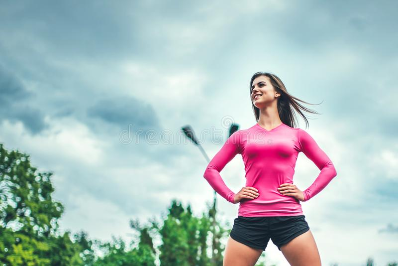 Pretty sporty girl workout outdoor with big tire stock photos