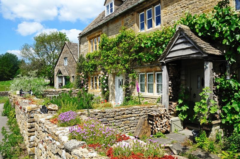 Pretty stone cottages, Lower Slaughter. Pretty stone cottages in the centre of the village, Lower Slaughter, Cotswolds, Gloucestershire, England, UK, Western royalty free stock photography