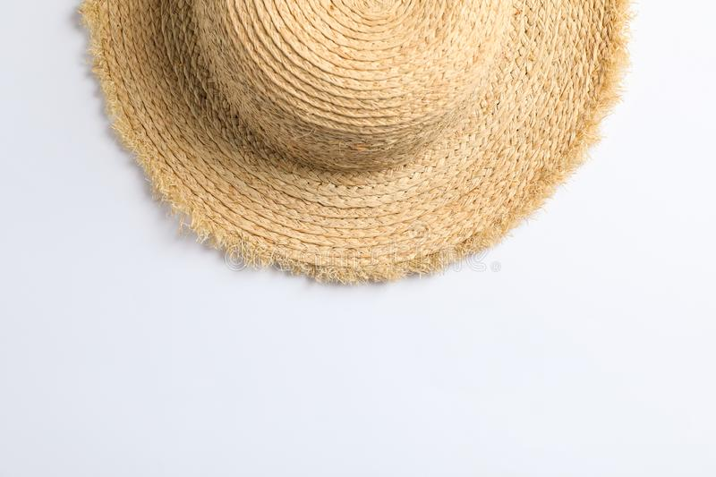 Pretty straw hat on white background. Space for text royalty free stock photography
