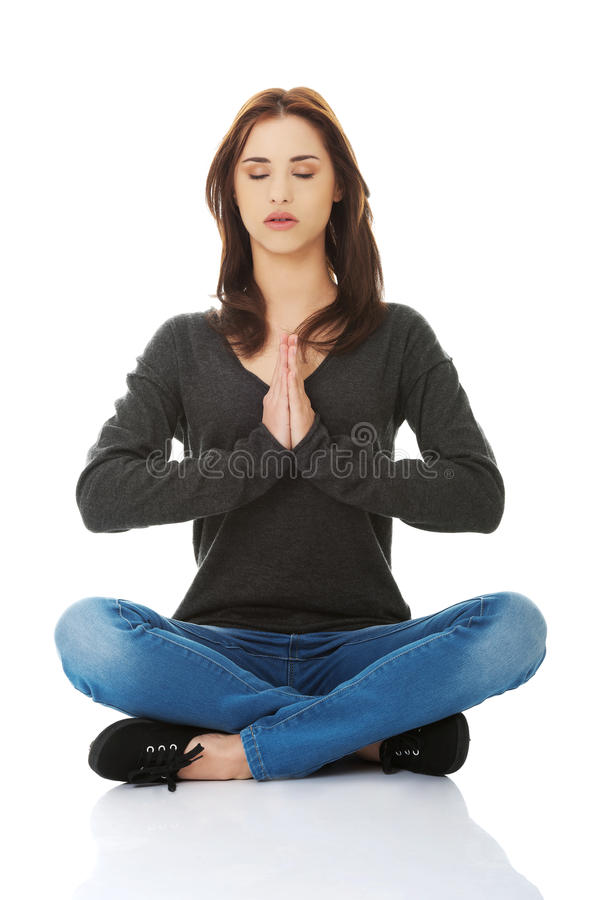 Free Pretty Student Girl Meditating In Lotus Pose. Royalty Free Stock Images - 45807659