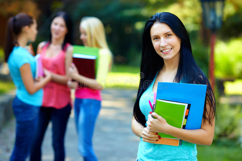 Pretty student with group of people on background royalty free stock photos