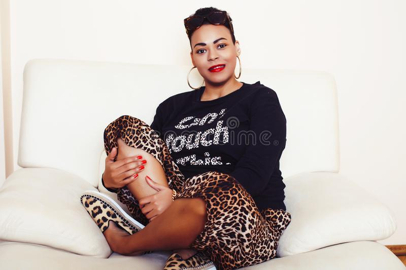 Pretty stylish african american big mama woman well dressed. swag relax at home, leopard print on clothers. fashion look royalty free stock photos