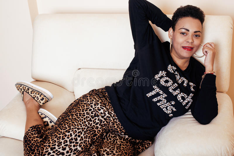 Pretty stylish african american big mama woman well dressed. swag relax at home, leopard print on clothers. fashion look. Sunglasses stock photo
