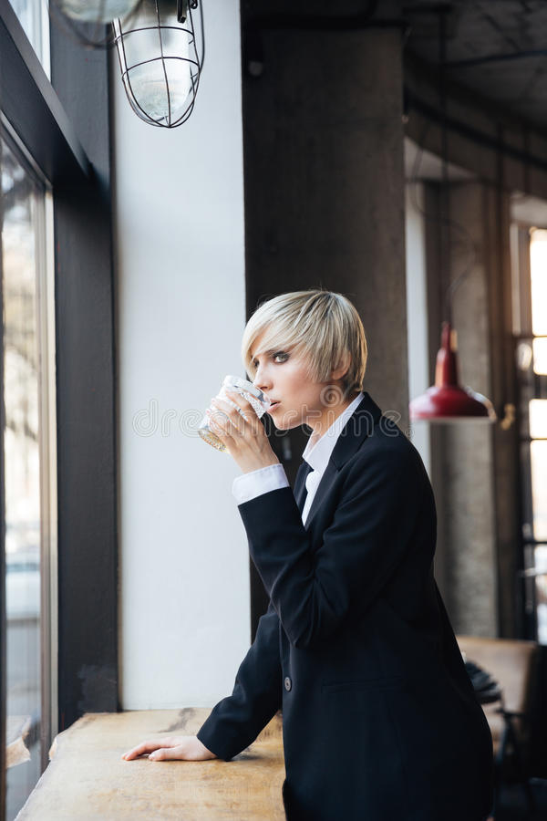 Download Pretty Stylish Blonde Girl Drinking At He Windowsill In Cafe Stock  Image   Image Of
