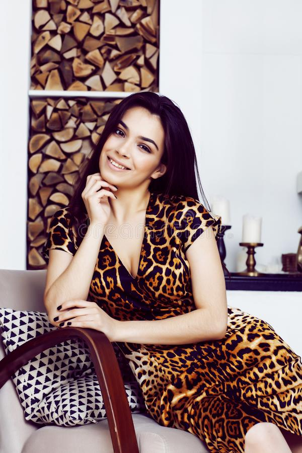 Pretty stylish woman in fashion dress with leopard print in luxu. Ry rich room interior, lifestyle people concept, modern brunette royalty free stock images
