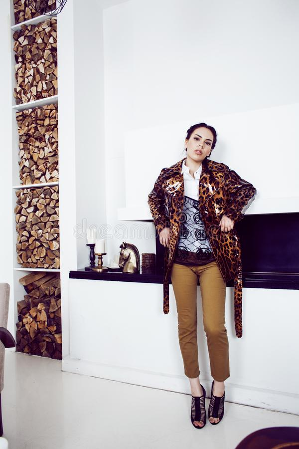 Pretty stylish woman in fashion dress with leopard print in luxu. Ry rich room interior, lifestyle people concept, modern brunette stock photo