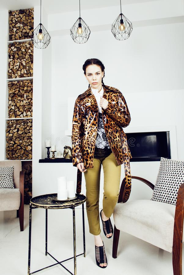 Pretty stylish woman in fashion dress with leopard print in luxury house interior, lifestyle people concept stock images