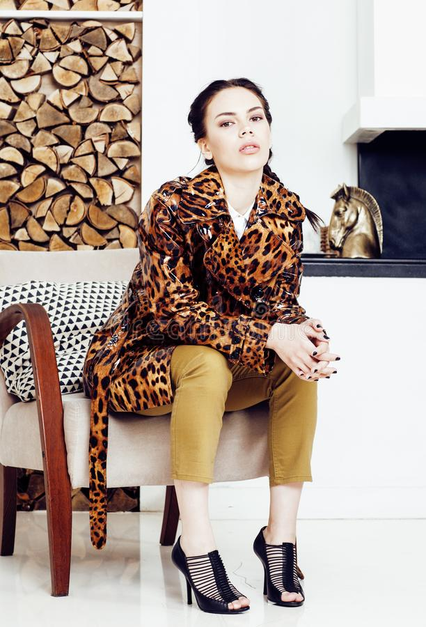 Pretty stylish woman in fashion dress with leopard print in luxury house interior, lifestyle people concept royalty free stock photos