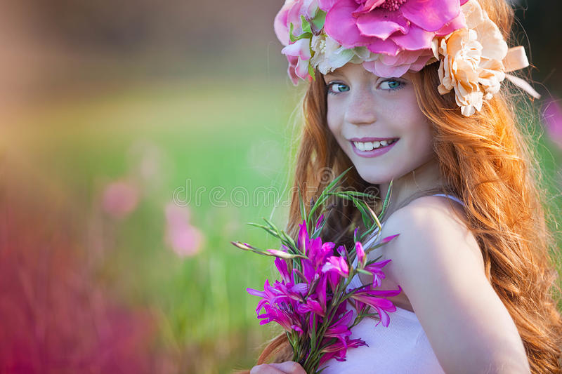 Pretty summer girl with crown of flowers stock image