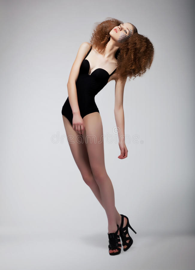 Pretty supermodel redhead woman - sexiness royalty free stock image
