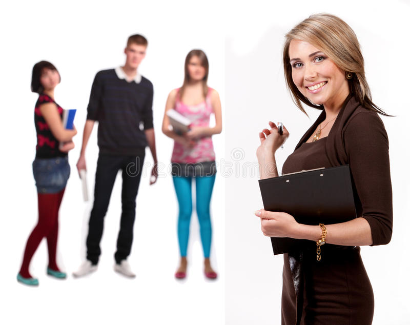 Pretty teacher and students stock image