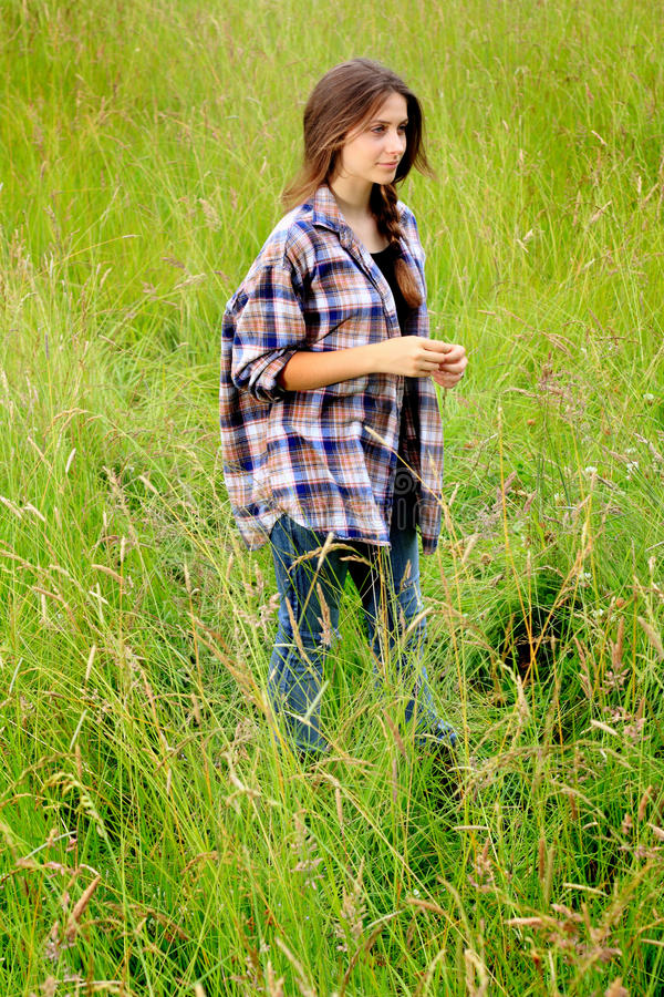 Pretty Teen Girl in Field stock images