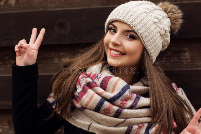 Pretty teen girl is wearing warm winter clothes royalty free stock photos
