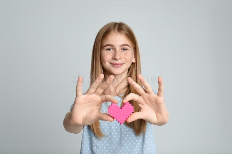 Pretty teenage girl with decorative heart stock photo