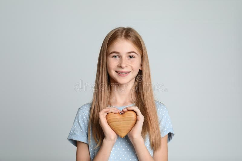 Pretty teenage girl with decorative heart stock photos