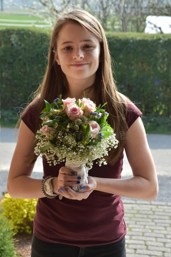 Young girl with flower bouquet royalty free stock photography