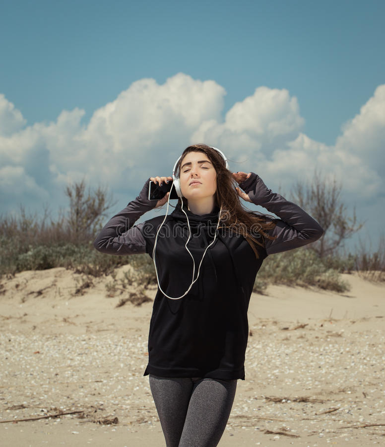 Pretty teenage girl with headphones listening to music royalty free stock images