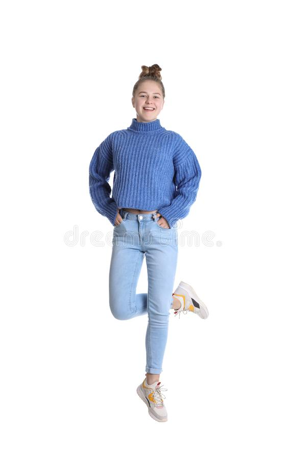Pretty teenage girl jumping on background royalty free stock images