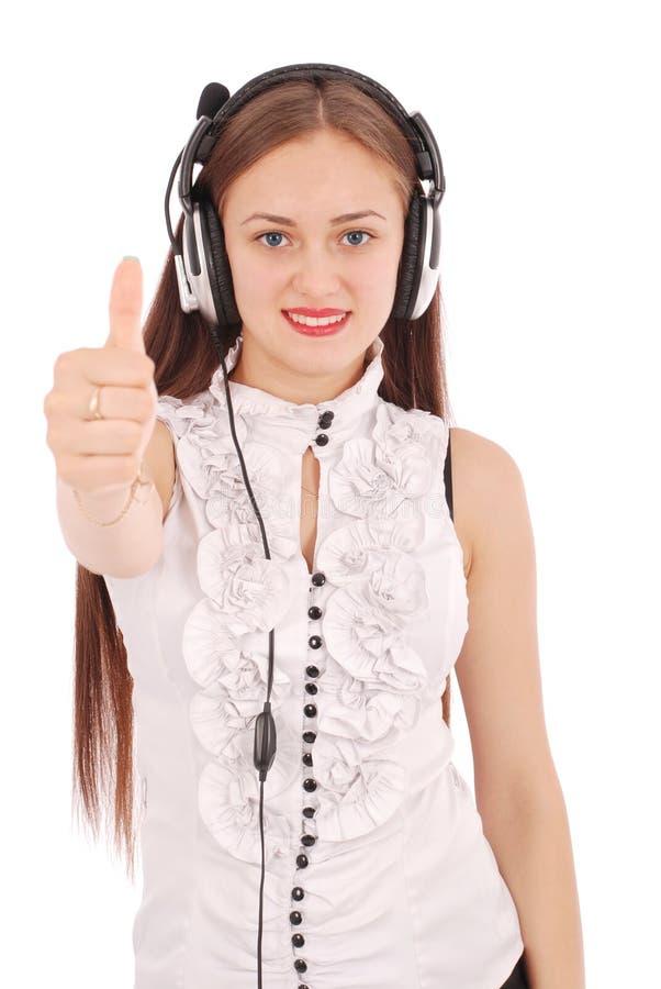 Pretty teenage girl listening music on her headphones stock image