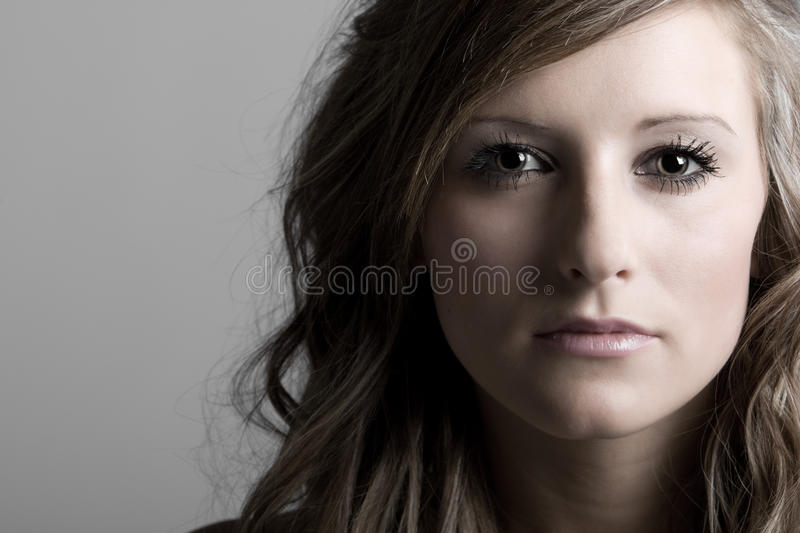 Pretty Teenage Girl Looking into the Camera. Shot of a Pretty Teenage Girl Looking into the Camera royalty free stock photo
