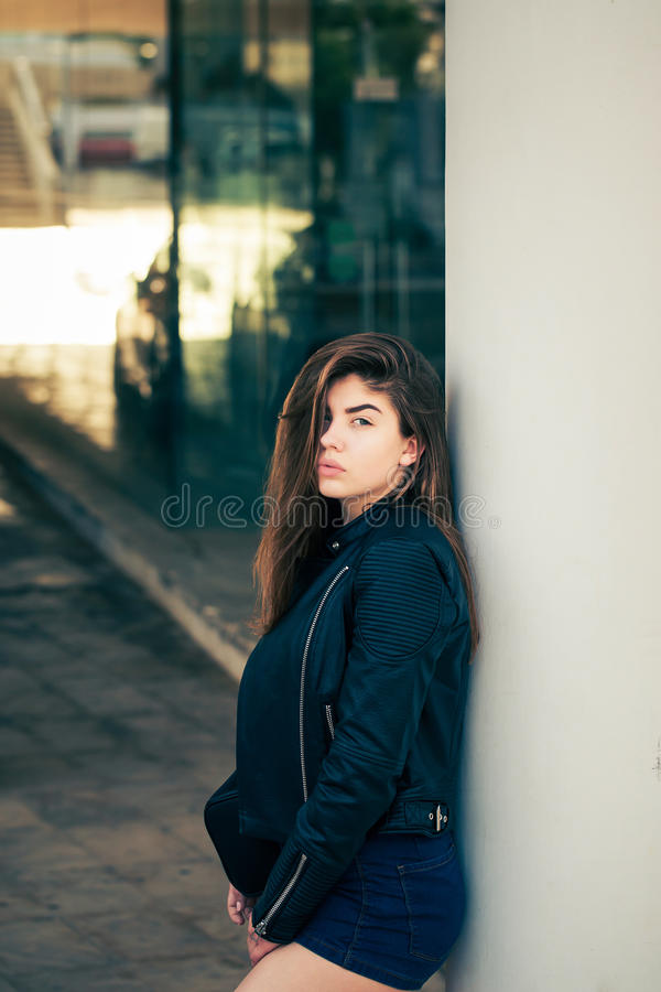 Pretty teenage girl posing on the street stock images