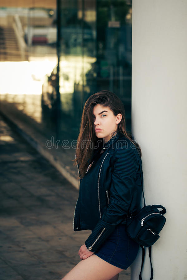 Pretty teenage girl posing on the street royalty free stock image