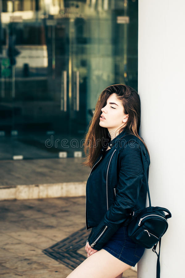 Pretty teenage girl posing on the street stock image