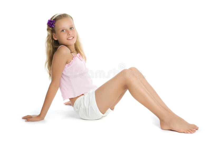 Pretty teenage girl sit on floor royalty free stock photos