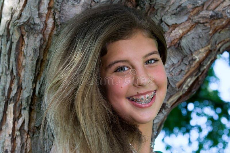 Pretty teenage girl smile stock photo