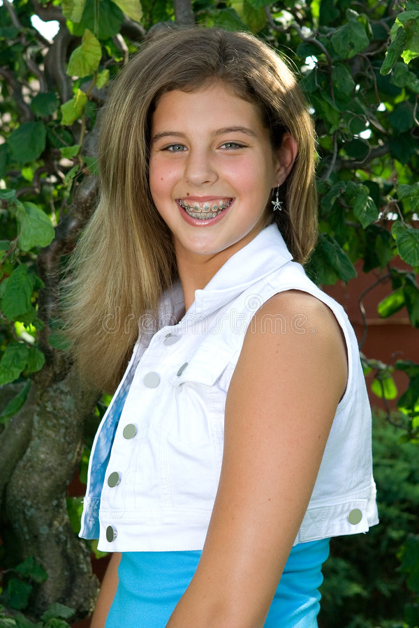 Pretty teenage girl striking a pose royalty free stock photo
