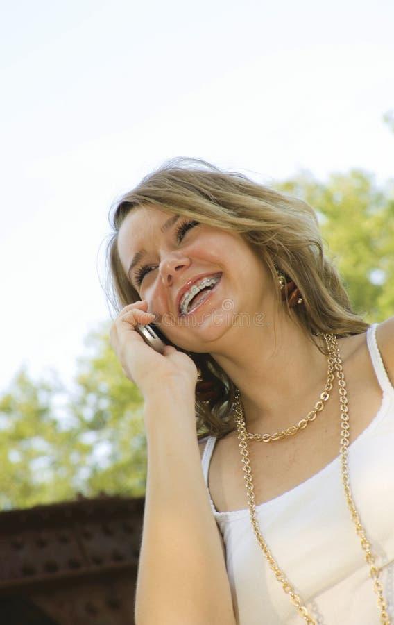 Pretty Teenage Girl talking on mobile phone royalty free stock photo