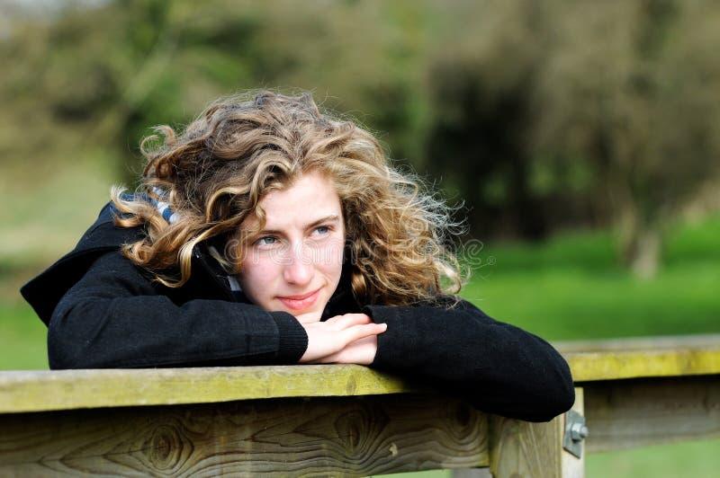 Pretty teenage girl thinking royalty free stock photo