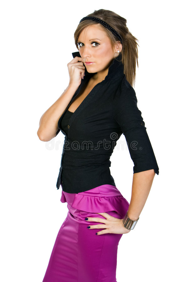 Pretty Teenager in Black Top and Pink Skirt. Shot of a Pretty Teenager in Black Top and Pink Skirt royalty free stock photo