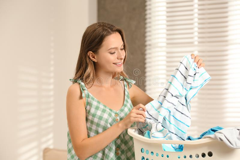 Pretty teenager with clean laundry before ironing. At home royalty free stock photos