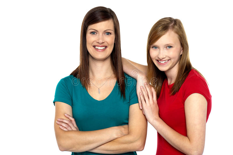 Pretty teenager girl with her mother royalty free stock photo