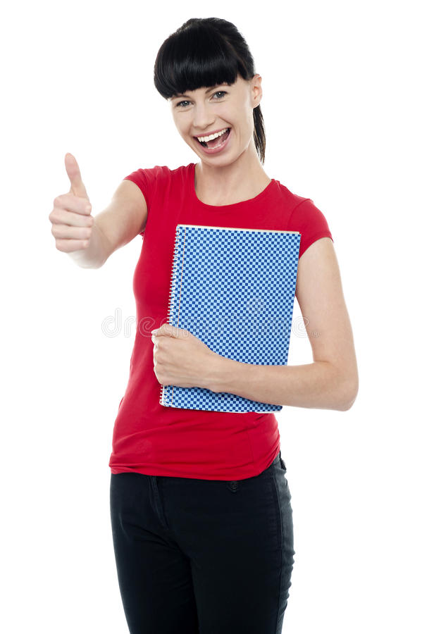 Pretty teenager holding notebook
