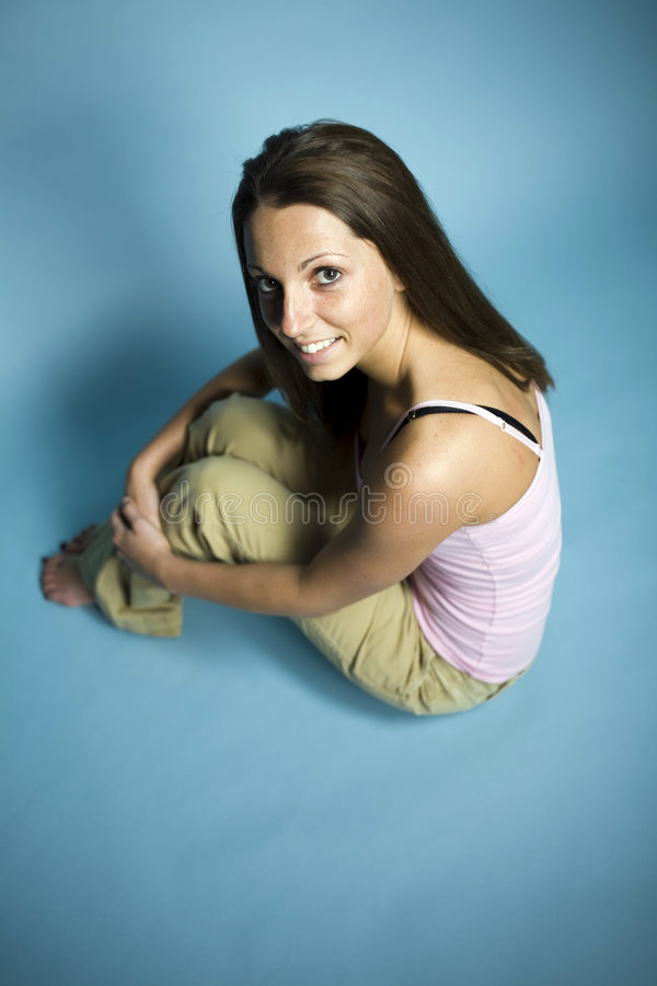 Pretty teenager sat on floor stock images