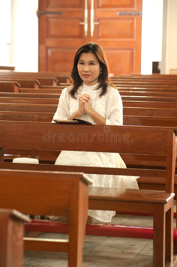 Pretty Thai woman is Praying in Retro styled royalty free stock photos