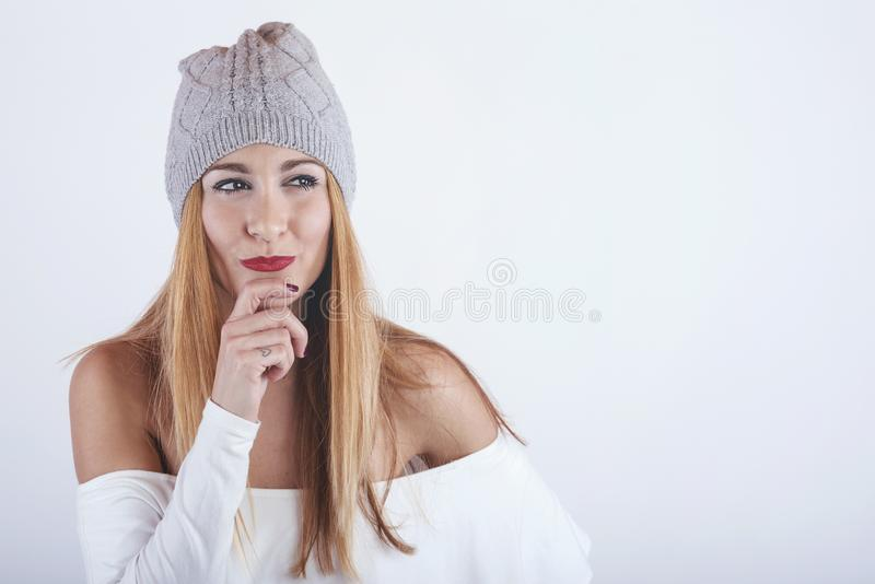 Pretty and thoughtful girl. On white background stock photography