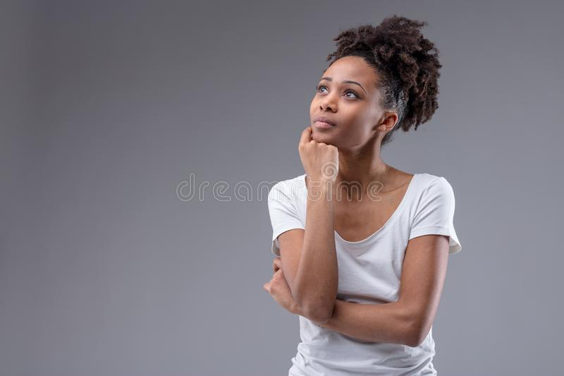 Pretty thoughtful young African woman royalty free stock photography