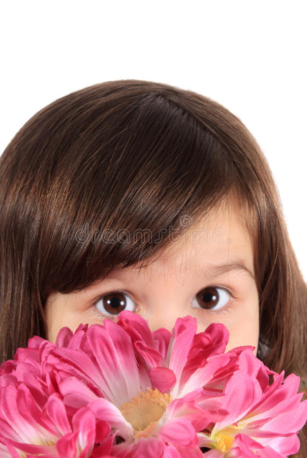 Pretty three year old girl with flowers royalty free stock photos