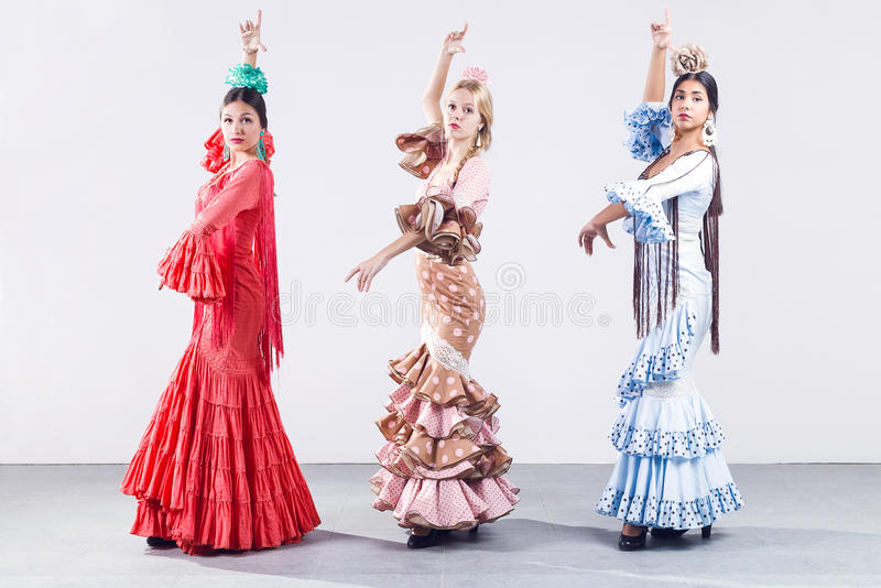 Pretty three young flamenco dancer in beautiful dress. stock photography