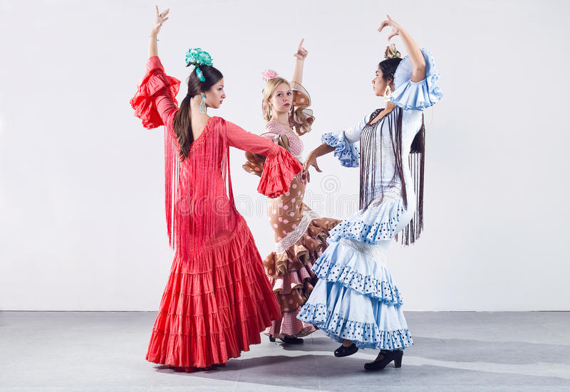 Pretty three young flamenco dancer in beautiful dress. stock images