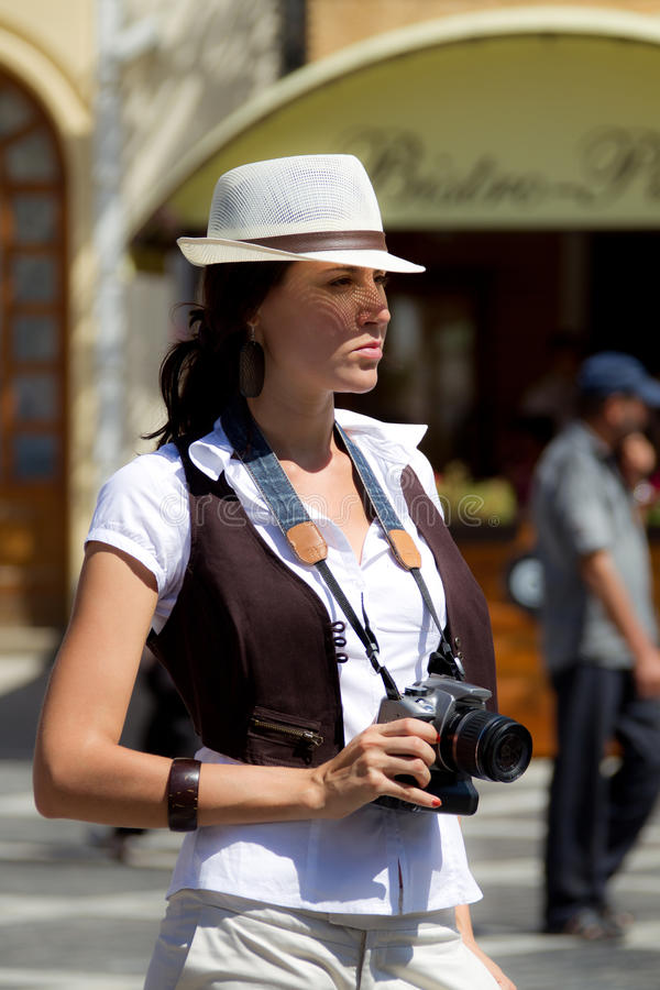 Download Pretty Tourist Girl With Camera Stock Image - Image: 21179595
