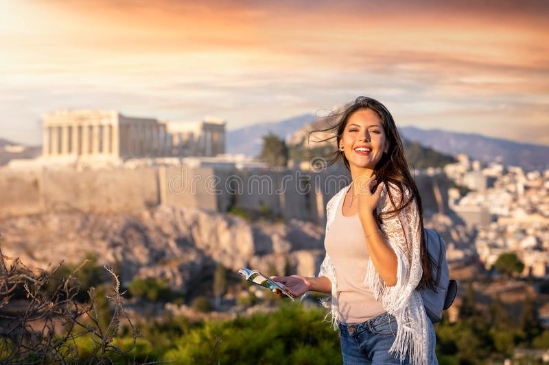 Woman stands in front of the Acropolis of Athens, Greece stock images
