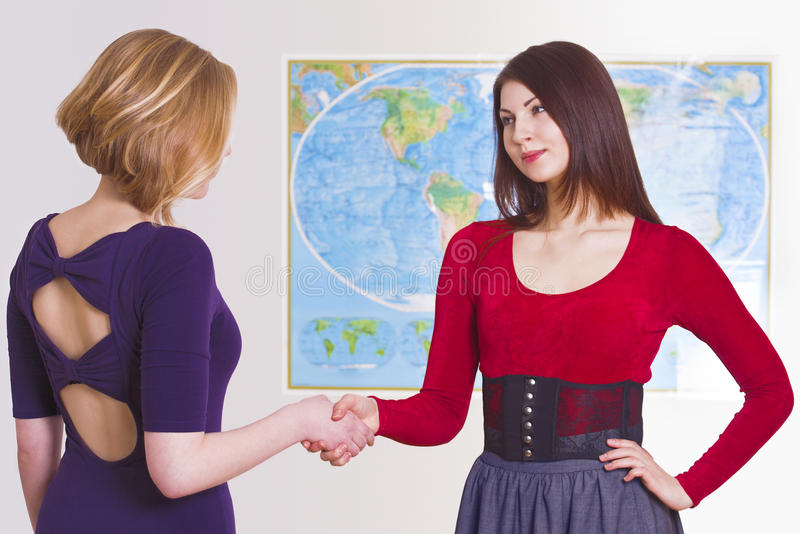Pretty travel agent greets client royalty free stock photo