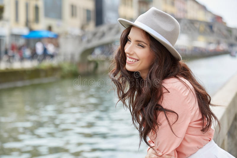 Pretty trendy girl posing at the city in Europe, stock photo