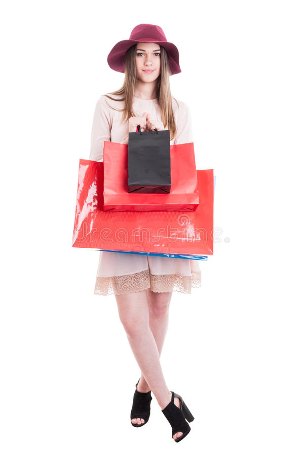 Pretty trendy woman showing black and red shopping bags. Pretty trendy woman in modern casual clothes showing black and red shopping bags isolated on white with royalty free stock photos